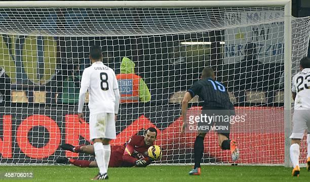 Inter Milan's goalkeeper from Slovenia Samir Handanovic stops a penalty kick during the Italian Serie A football match Inter Milan vs Verona on...