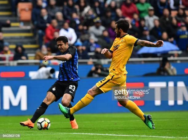Inter Milan's Italian Brazilian forward Eder vies with Hellas Verona's Italian defender Antonio Caracciolo during the Italian Serie A football match...