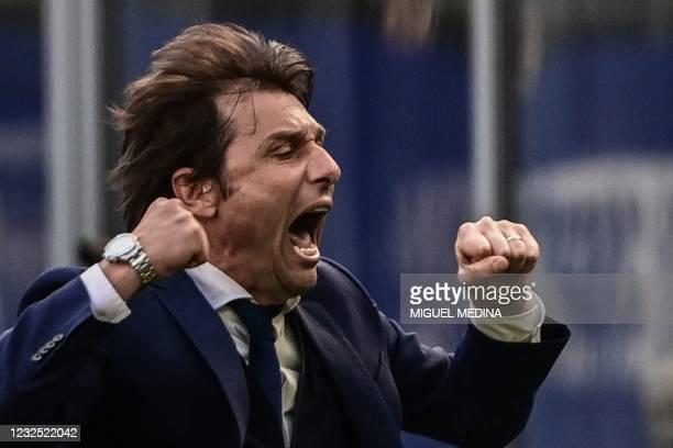 Inter Milan's Italian coach Antonio Conte celebrates at the end of the Italian Serie A football match Inter Milan vs Hellas Verona on April 25, 2021...