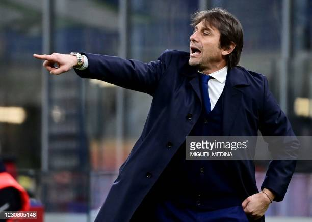 Inter Milan's Italian coach Antonio Conte gestures during the Italian Cup quarter final football match between Inter Milan and AC Milan on January...