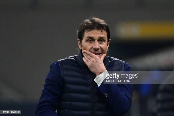 Inter Milan's Italian coach Antonio Conte reacts during the Italian Serie A football match Inter Milan vs Atalanta, on March 8, 2021 at the San Siro...