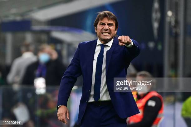 Inter Milan's Italian coach Antonio Conte reacts during the UEFA Champions League first round first leg group B football match between Inter Milan...