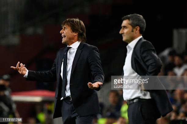 Inter Milan's Italian coach Antonio Conte reacts next to Barcelona's Spanish coach Ernesto Valverde during the UEFA Champions League Group F football...