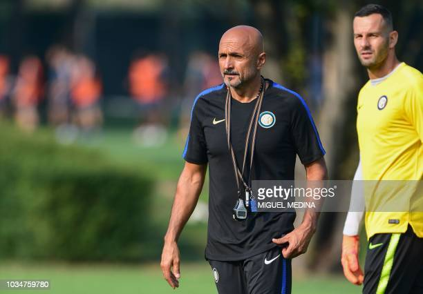 Inter Milan's Italian coach Luciano Spalletti and Inter Milan's Slovenian goalkeeper Samir Handanovic attend a training session on the eve of the...
