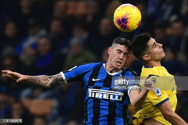 Inter Milan's Italian defender Alessandro Bastoni and Verona's Italian defender Davide Faraoni go for a header during the Italian Serie A football...