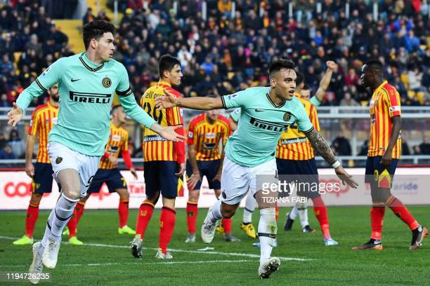Inter Milan's Italian defender Alessandro Bastoni celebrates with Inter Milan's Argentinian forward Lautaro Martinez after opening the scoring during...