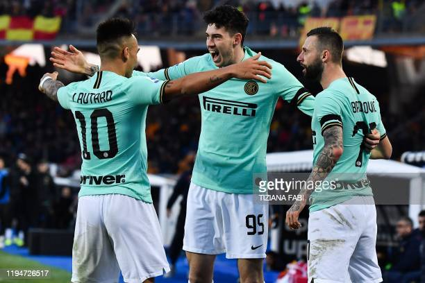 Inter Milan's Italian defender Alessandro Bastoni celebrates with Inter Milan's Croatian defender Marcelo Brozovic and Inter Milan's Argentinian...