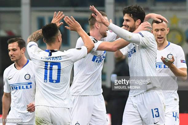 Inter Milan's Italian defender Andrea Ranocchia celebrates with teammates after scoring the second goal during the UEFA Europa League round of 32...