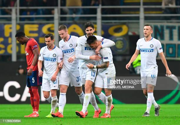Inter Milan's Italian defender Andrea Ranocchia celebrates with Inter Milan's Argentine forward Lautaro Martinez and teammates after scoring the...