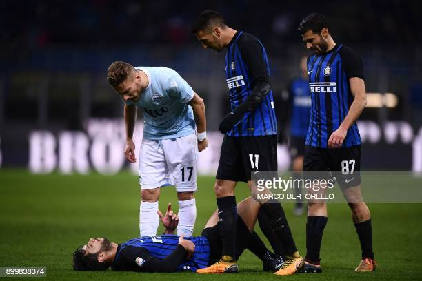 Inter Milan's Italian defender Andrea Ranocchia reacts after receiving an injury during the Italian Serie A football match Inter Milan versus Lazio...
