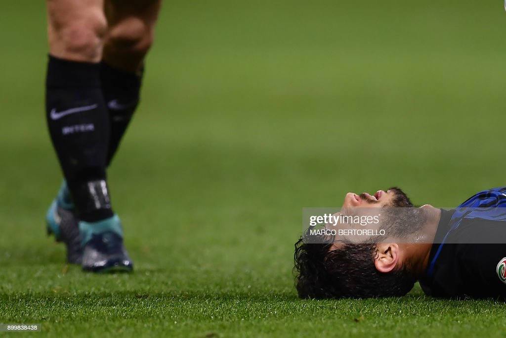 TOPSHOT - Inter Milan's Italian defender Andrea Ranocchia reacts after receiving an injury during the Italian Serie A football match Inter Milan versus Lazio on December 30, 2017 at the San Siro Stadium in Milan. /