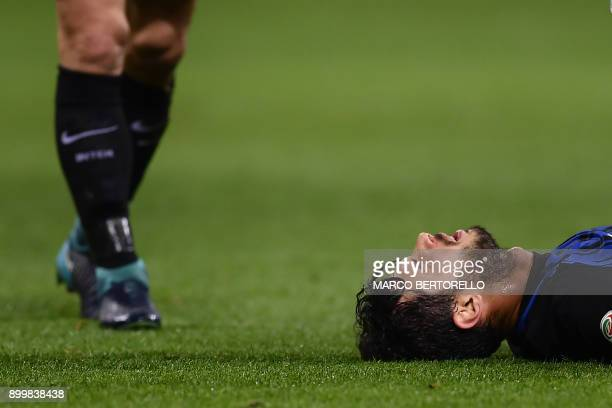 TOPSHOT Inter Milan's Italian defender Andrea Ranocchia reacts after receiving an injury during the Italian Serie A football match Inter Milan versus...