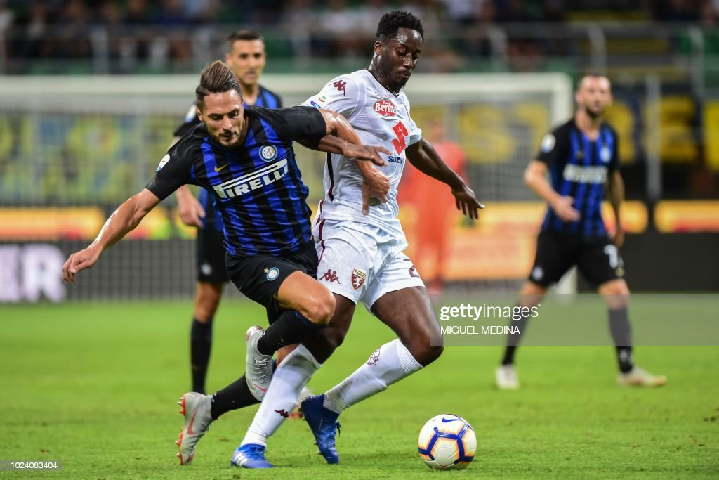 Inter Milan's Italian defender Danilo D'Ambrosio (L) and Torino's French midfielder Souahilo Meite go for the ball during the Italian Serie A football match Inter Milan vs Torino on August 26, 2018 at the San Siro Stadium in Milan.