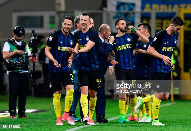 Inter Milan's Italian defender Danilo D'Ambrosio celebrates with teammates after scoring a goal during the Italian Serie A football match between...
