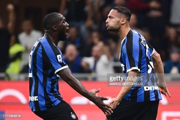 Inter Milan's Italian defender Danilo D'Ambrosio celebrates with Inter Milan's Belgian forward Romelu Lukaku after scoring during the Italian Serie A...