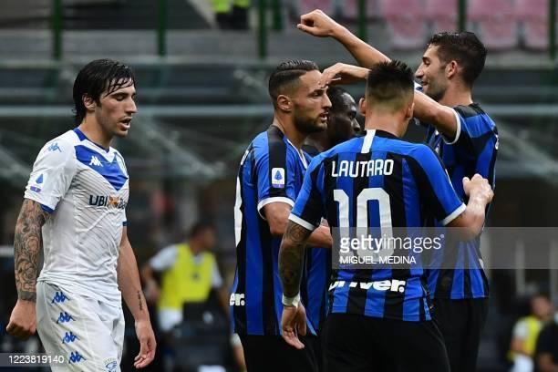 Inter Milan's Italian defender Danilo D'Ambrosio celebrates with Inter Milan's Italian midfielder Roberto Gagliardini and Inter Milan's Argentinian...