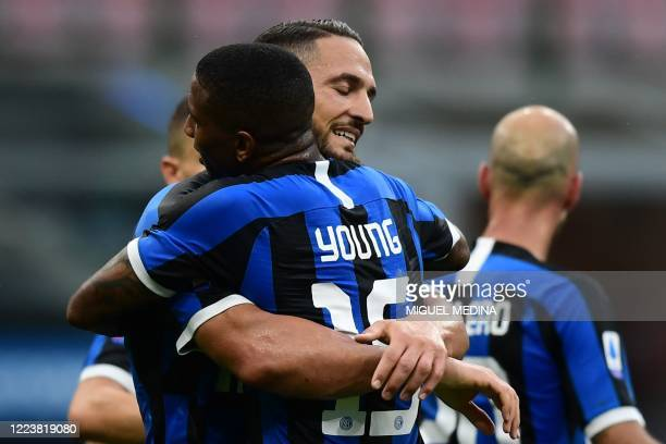 Inter Milan's Italian defender Danilo D'Ambrosio embraces Inter Milan's English midfielder Ashley Young after scoring the third goal during the...
