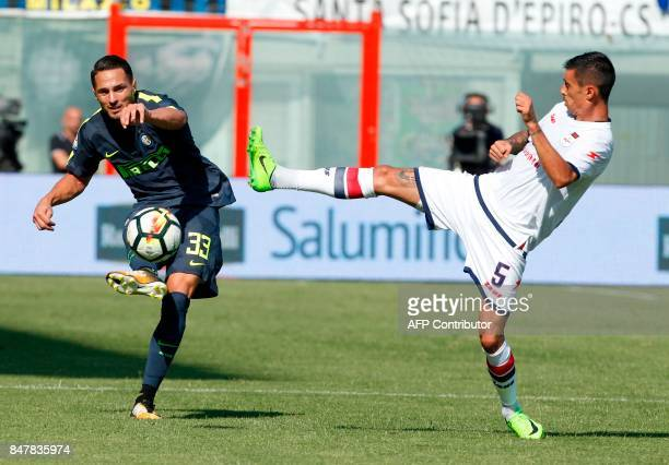 Inter Milan's Italian defender Danilo D'Ambrosio fights for the ball with Crotone's Romanian forward Adrian Stoian during the Italian Serie a...
