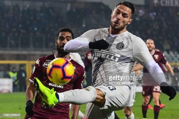 Inter Milan's Italian defender Danilo D'Ambrosio kicks the ball as Torino's French defender Koffi Djidji looks on during the Italian Serie A football...