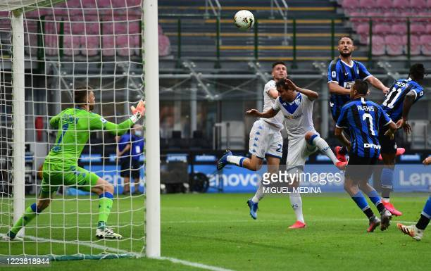 Inter Milan's Italian defender Danilo D'Ambrosio scores a header during the Italian Serie A football match Inter vs Brescia played behind closed...