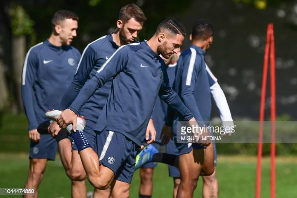 Inter Milan's Italian defender Danilo D'Ambrosio stretches during a training session on October 2 2018 at the Appiano Gentile training ground near...
