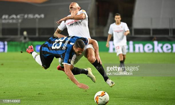 Inter Milan's Italian defender Danilo D'Ambrosio vies for the ball with Sevilla's Argentinian midfielder Lucas Ocampos during the UEFA Europa League...
