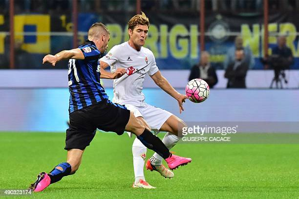 Inter Milan's Italian defender Davide Santon vies for the ball with Fiorentina's Spanish defender Marcos Alonso Mendoza during the Serie A football...