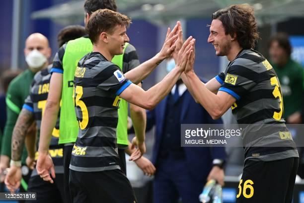 Inter Milan's Italian defender Matteo Darmian celebrates with Inter Milan's Italian midfielder Nicolo Barella after opening the scoring during the...