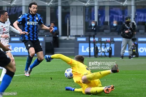 Inter Milan's Italian defender Matteo Darmian prepares to shoot and score the opening goal past Cagliari's Italian goalkeeper Guglielmo Vicario...