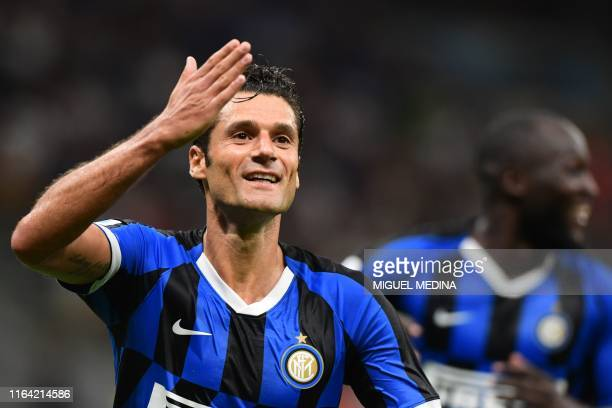 Inter Milan's Italian forward Antonio Candreva celebrates after scoring during the Italian Serie A football match Inter Milan vs US Lecce on August...
