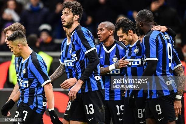 Inter Milan's Italian forward Antonio Candreva celebrates with teammates after opening the scoring during the Italian Cup round of 8 football match...