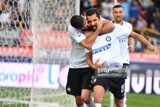 Inter Milan's Italian forward Antonio Candreva celebrates with Inter Milan's Italian midfielder Roberto Gagliardini after scoring a goal during the...