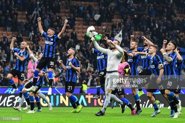 TOPSHOT Inter Milan's Italian forward Sebastiano Esposito and teammates acknowledge the public at the end of the UEFA Champions League Group F...