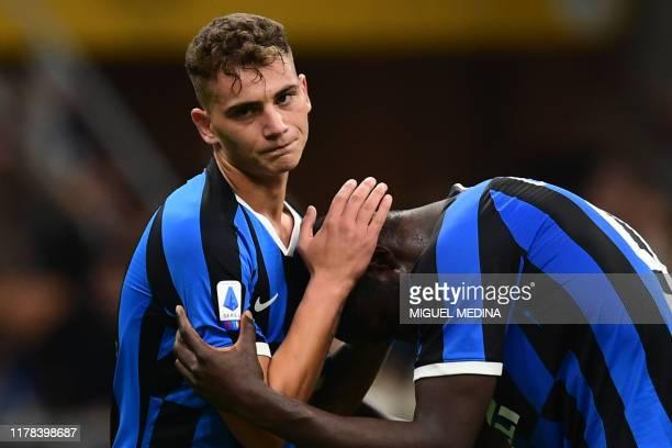 Inter Milan's Italian forward Sebastiano Esposito reacts with Inter Milan's Belgian forward Romelu Lukaku after missing a last second opportunity...