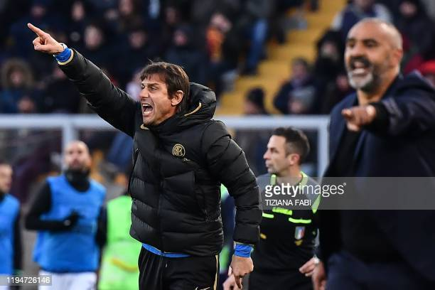 Inter Milan's Italian head coach Antonio Conte and Lecce's head coach Fabio Liverani give instructions during the Italian Serie A football match...