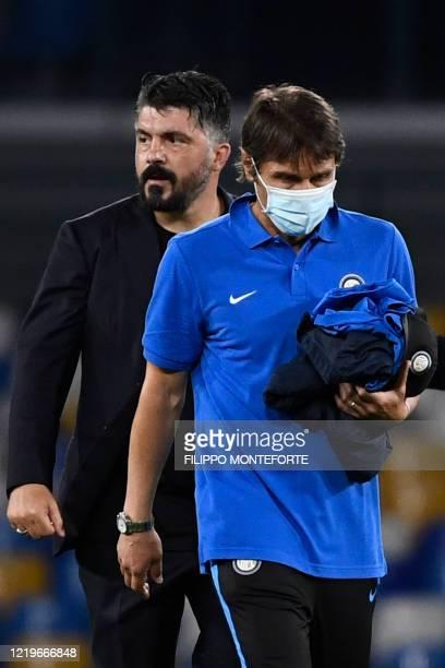 Inter Milan's Italian head coach Antonio Conte and Napoli's Italian head coach Gennaro Gattuso leave the pitch at the end of the Italian Cup...