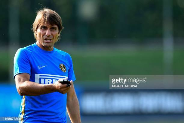 Inter Milan's Italian head coach Antonio Conte gestures during a training session at the training ground of Appiano Gentile, north of Milan on...