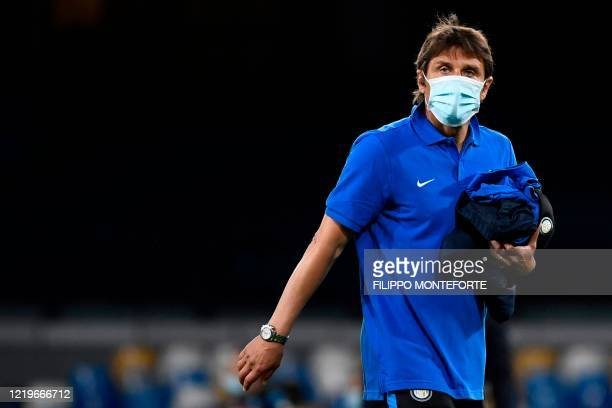 Inter Milan's Italian head coach Antonio Conte leaves the pitch at the end of the Italian Cup semi-final second leg football match Napoli vs Inter...