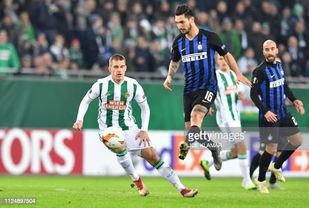 Inter Milan's Italian midfielder Matteo Politano and Rapid Wien's Bosnian midfielder Srdjan Grahovac vie for the ball during the UEFA Europa League...
