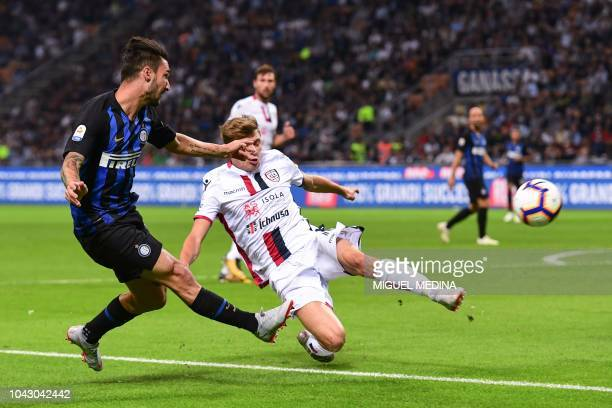 Inter Milan's Italian midfielder Matteo Politano centres the ball past Cagliari's Italian midfielder Nicolo Barella during the Italian Serie A...