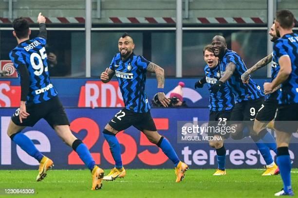Inter Milan's Italian midfielder Nicolo Barella celebrates with Inter Milan's Chilean midfielder Arturo Vidal , Inter Milan's Belgian forward Romelu...