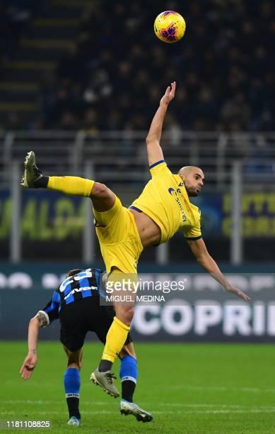 Inter Milan's Italian midfielder Nicolo Barella collides with Verona's Moroccan midfielder Sofyan Amrabat during the Italian Serie A football match...
