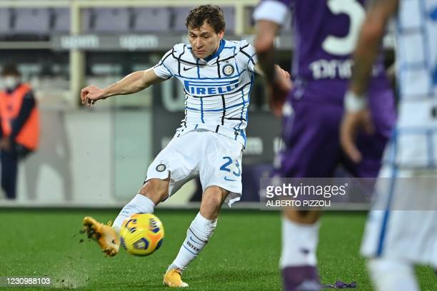 Inter Milan's Italian midfielder Nicolo Barella shoots to open the scoring during the Italian Serie A football match Fiorentina vs Inter Milan on...