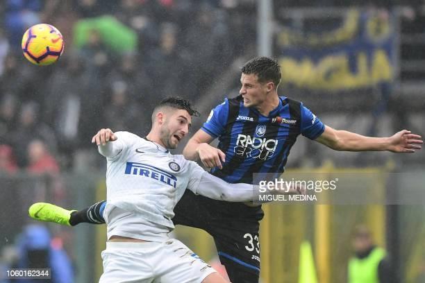 Inter Milan's Italian midfielder Roberto Gagliardini and Atalanta's Dutch defender Hans Hateboer go for a header during the Italian Serie A football...
