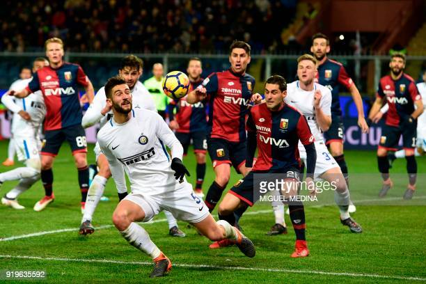 Inter Milan's Italian midfielder Roberto Gagliardini vies for the ball during the Italian Serie A football match between Genoa and Inter Milan at the...