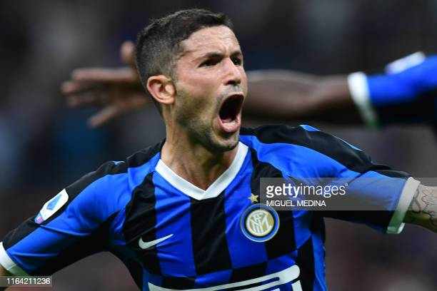 Inter Milan's Italian midfielder Stefano Sensi celebrates after scoring during the Italian Serie A football match Inter Milan vs US Lecce on August...