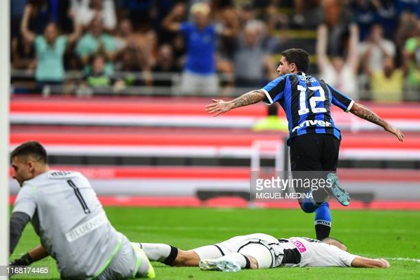 Inter Milan's Italian midfielder Stefano Sensi celebrates after opening the scoring during the Italian Serie A football match Inter Milan vs Udinese...