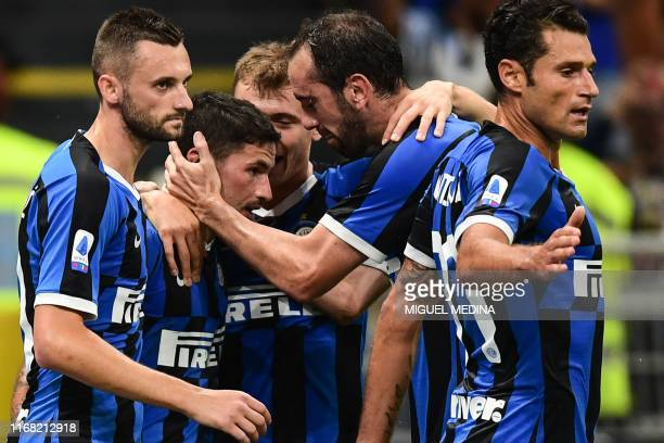 Inter Milan's Italian midfielder Stefano Sensi celebrates with Inter Milan's Uruguayan defender Diego Godin and teammates after opening the scoring...