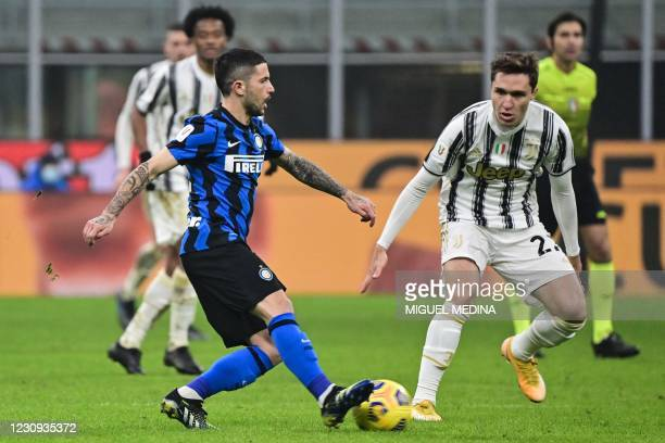 Inter Milan's Italian midfielder Stefano Sensi challenges Juventus' Italian forward Federico Chiesa during the Italian Cup semifinal first leg...