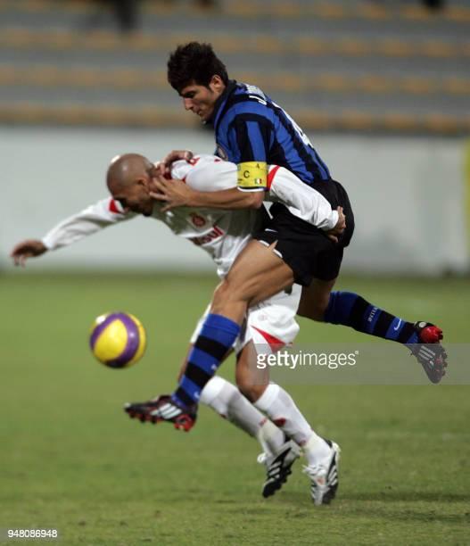 Inter Milan's Javier Zanetti duels Brazilain Internacional de Port Alegre's Pablo Guinazu during their football bout at the second Mohammad Bin...